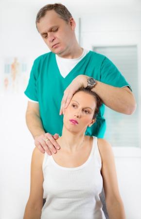 Chiropractor adjusting neck muscles Zdjęcie Seryjne