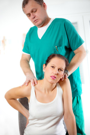 back bone: Chiropractor massage the female patient spine and back Stock Photo