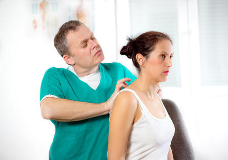 spinal adjustment: Chiropractor massage the female patient spine and back Stock Photo