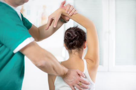 knee bend: Chiropractor massage the female patient spine and back Stock Photo