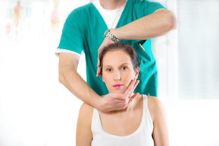 osteopath: Chiropractor adjusting neck muscles Stock Photo