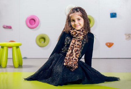 playcentre: The little girl posing in a playroom