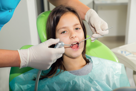 ordination: little girl patient to the dentist