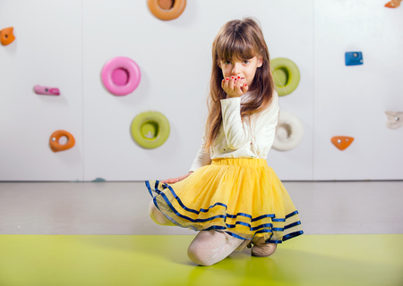 playroom: The little girl posing in a playroom
