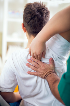 spinal manipulation: Chiropractor doing adjustment on male patient