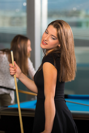 pool game: Pool game. group of friends playing pool together.