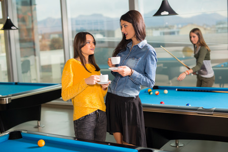 billiards rooms: Pool game. group of friends playing pool together.