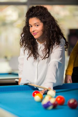 snooker: Young girl playing snooker Stock Photo