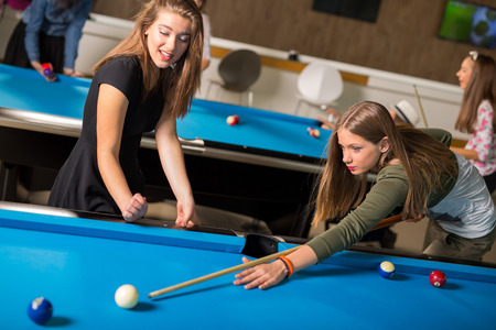 snooker rooms: Pool game. group of friends playing pool together.