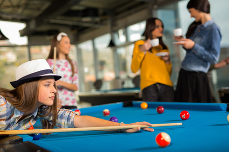 billiards room: Pool game. group of friends playing pool together.