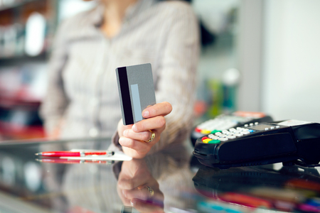 customer focus: Woman holding credit card in hand