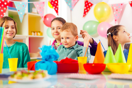 birthday party kids: Group of adorable kids having fun at birthday party