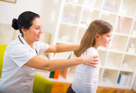 spinal adjustment: Chiropractor doing adjustment on female patient Stock Photo