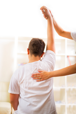 spinal adjustment: Chiropractor doing adjustment on male patient