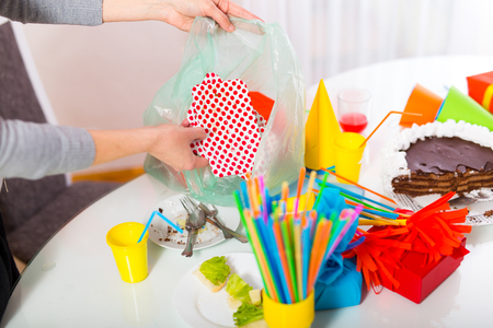 party poppers: Woman cleans  mess after the childrens birthday Stock Photo