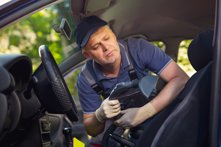 rag wheel: Cleaning of interior of the car with vacuum cleaner