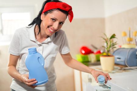 householder: Householder woman using conditioner for washing machine
