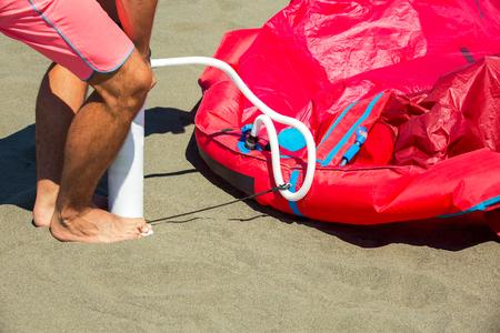kiting: Kitesurfers on the beach prepare sport equipment for riding