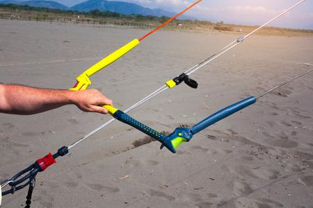 kiter: Kitesurfing action on the beach