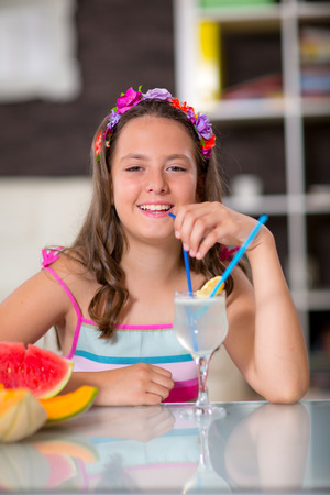 kindergartner: Summer refreshment. The girl drinking lemonade in front of her was watermelon and melon