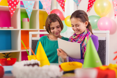 Two girls having fun on birthday party