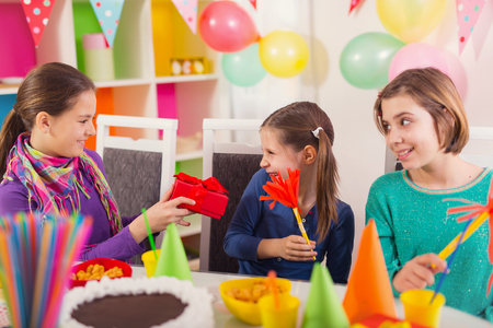 kids birthday party: Group of adorable kids having fun at birthday party