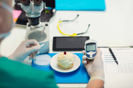 Laboratory testing of glucose to cake, selective focus Stock Photo