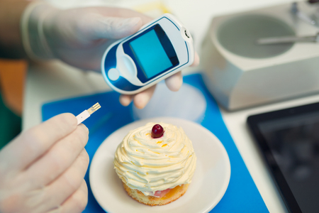 glucose: Laboratory testing of glucose to cake, selective focus Stock Photo