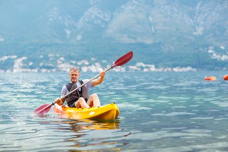 activ: Mature man kayaking on the sea