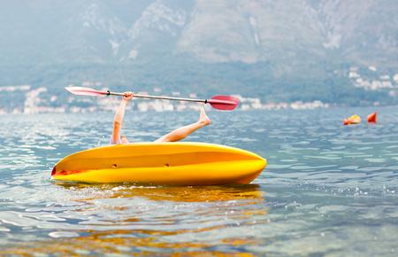 activ: Mature man kayaking on the sea, falling out of the kayak Stock Photo