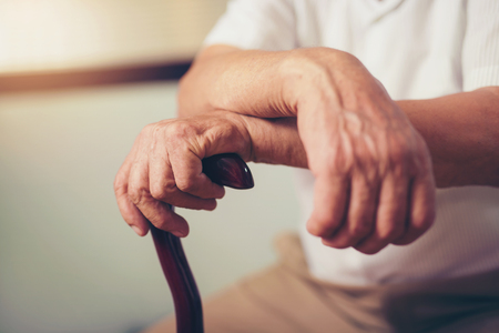 puckered: Hand of a senior man holding a stick