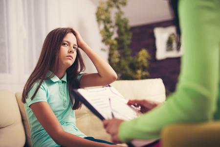 Experienced psychiatrist diagnosing teenage girl with mental problem 写真素材