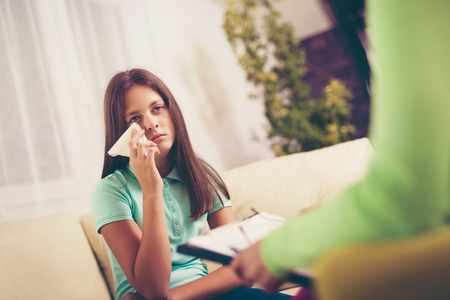 diagnosing: Experienced psychiatrist diagnosing teenage girl with mental problem Stock Photo