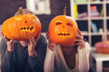 Man and woman having fun with Halloween pumpkin Stock Photo
