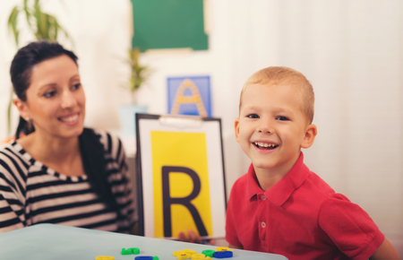 Speech therapist teaches the boys to say the letter R