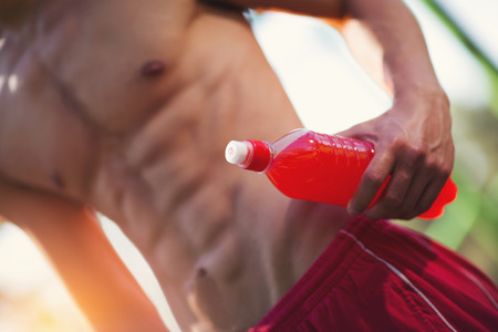 Close-up abdominal muscles of man outdoor Stock Photo