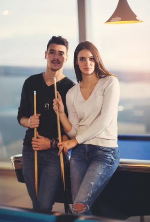snooker halls: Couple playing billiard