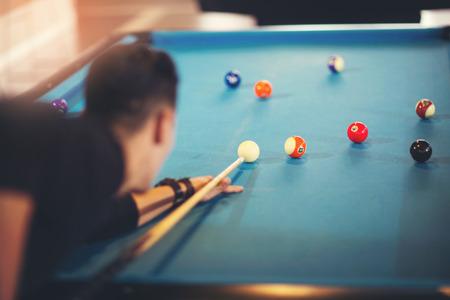 billiards halls: Handsome man playing pool in pub