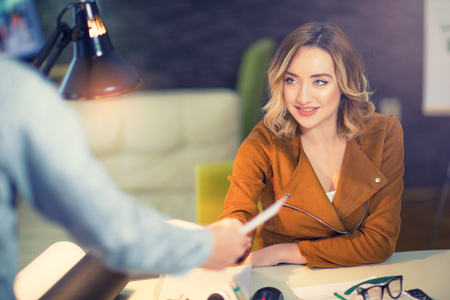 Guy giving a curriculum vitae to his interviewer in a job interview Stock Photo