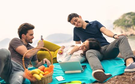 Three friends having fun at the beach Stock Photo
