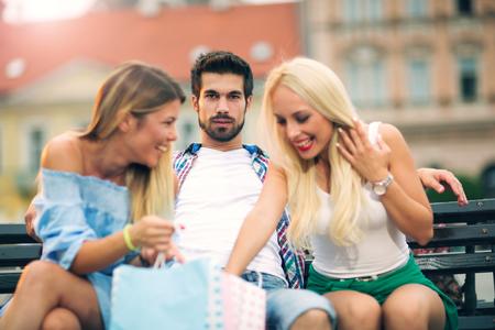 Three friends having fun on the bench Stock Photo