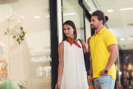 Beautiful couple enjoy shopping together in shopping mall