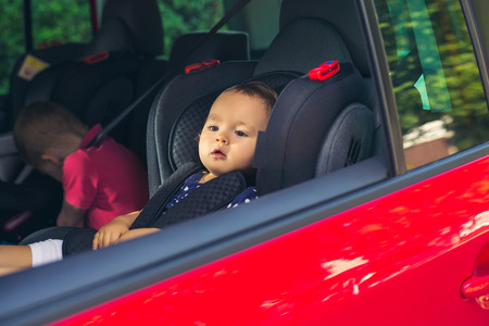 Baby girl in a car seat for safety