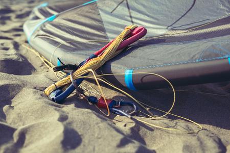 Kitesurf equipment on the sand beach Banco de Imagens