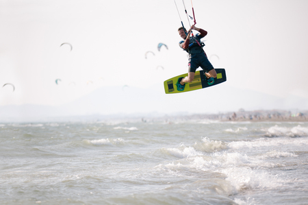 Kiteboarder athlete performing kiteboarding kitesurfing tricks unhooked Banco de Imagens - 84979513