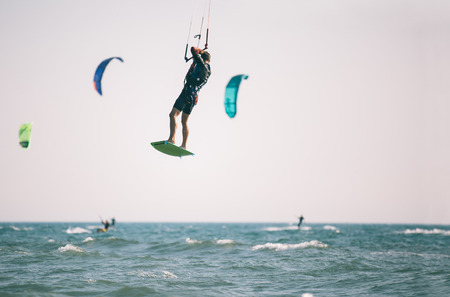 Kiteboarder athlete performing kiteboarding kitesurfing tricks unhooked