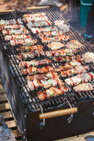 Roasted meat cooked at barbecue. Grill on charcoal and flame. Stock Photo