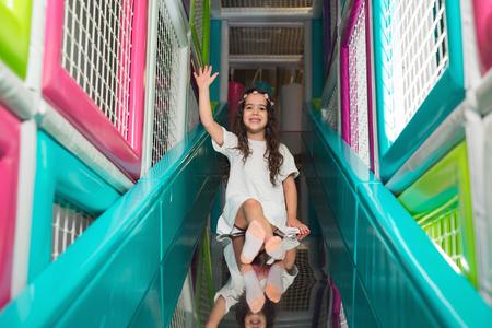 Children playing on colorful kindergarten playground Stock Photo
