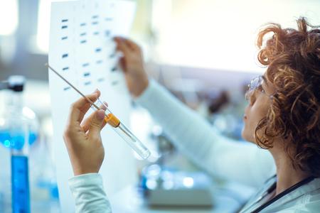 Scientist looking at DNA Reklamní fotografie - 89454775