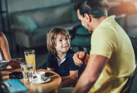 Father and son having great time in a restaurant Stock fotó